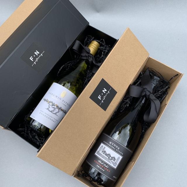 rượu vang làm quà tặng tân gia